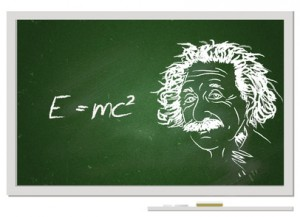 Formula e=mc2/ Albert Einstein portrait with chalk on chalkboard and his famous formula.